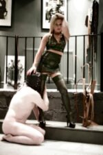 Mistress Athena in Latex with slave