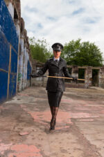 Outdoors in full leather military uniform